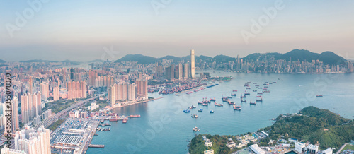 Obraz na plátně Aerial view of Victoria Harbour, from the west side, Hong Kong, daytime