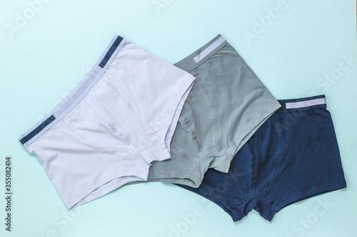Obraz Set of men's underwear on a light background. - fototapety do salonu