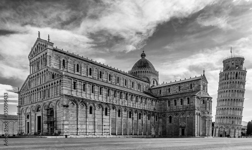 Black and white view of the famous Piazza dei Miracoli square and the leaning tower, in the historic center of Pisa, Italy, completely deserted due to the Covid-19 coronavirus pandemic