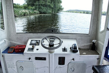 Bridge Of Small River Ferry Boat With Black Steering Wheel