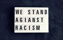 We Stand Against Racism  Text ...