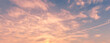 Cloudy sky at sunset or sunrise with sunlight. Abstract background for design.