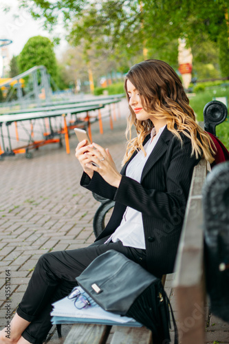 Office worker business woman working and holding online meetings in the park outside Canvas Print