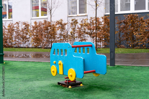 фотография Toy car on the playground after rain. Nobody plaing