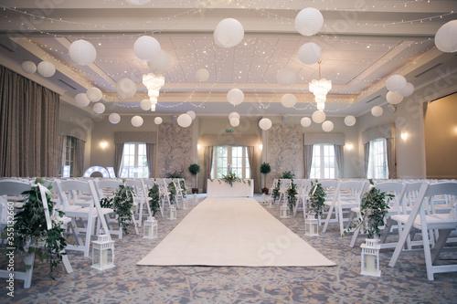 Fototapeta Room set up for wedding in white