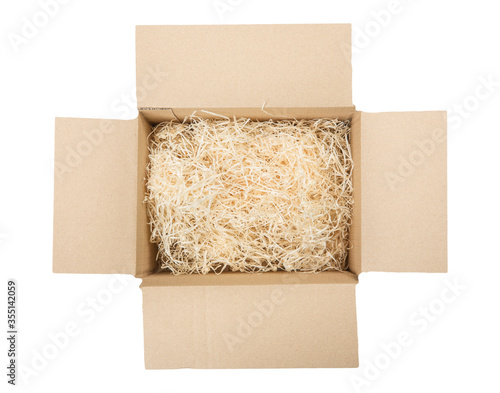 Valokuvatapetti Top view of open cardboard box with shredded wood excelsior for filling inside