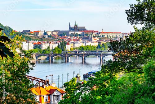 Fényképezés View of Prague Castle from Vysehrad with lush green spring trees, Prague, Czech