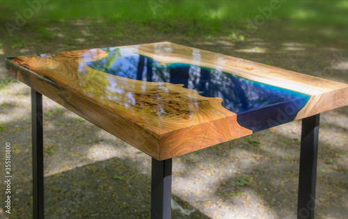 Valokuva Beautiful wooden table made of elm slab with epoxy resin filling