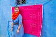 Leinwanddruck Bild - Girl tourist in the famous blue city.