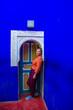 Leinwanddruck Bild - Tourist girl near the door with oriental decor.