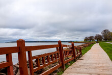 Redwood Painted Fence, Lines Wooden Walkway Winding Around  Ocean Cove In Charlottetown, Canada.