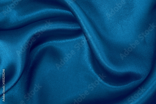 Photo Dark blue fabric cloth texture for background and design art work, beautiful crumpled pattern of silk or linen