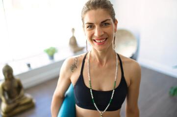 close portrait of a Nice yoga teacher woman in a studio indoors