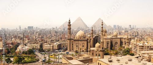 The Mosque-Madrassa of Sultan Hassan In front of the Giza Pyramids, Cairo, Egypt