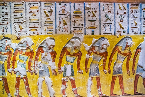 Fotografiet Burial chamber with colorful Egyptian hieroglyphics at the valley of the kings,