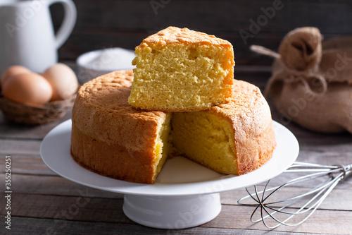Homemade sponge cake on a white plate Poster Mural XXL