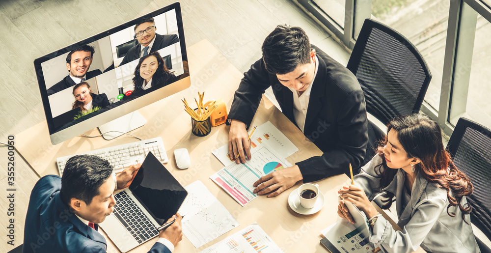 Fototapeta Video call group business people meeting on virtual workplace or remote office. Telework conference call using smart video technology to communicate colleague in professional corporate business.