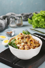 Salad With Ham, Eggs, Onion And Mushrooms In A White Bowl On Black Wooden Board, Vertical Format, Closeup