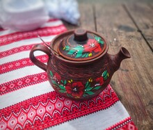 Vintage Brown Clay Teapot On A...