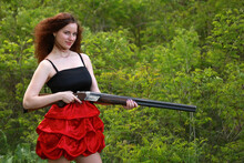Girl With A Hunting Rifle In H...