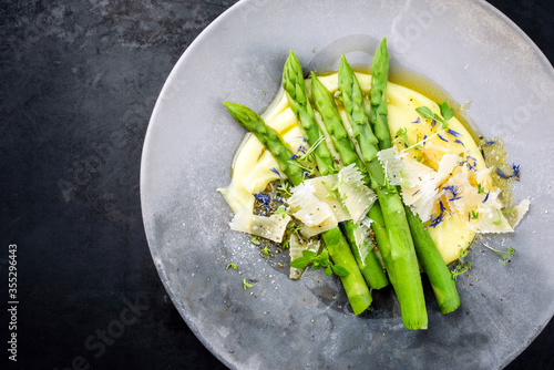 Fotografie, Obraz Traditional steamed green asparagus with mashed potato creme and parmesan as top