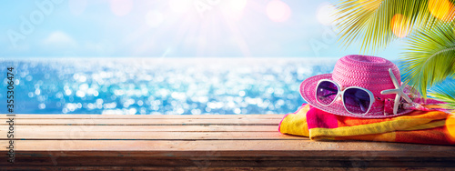 Beach Accessories On Table With Shiny Sea On Background Fototapet