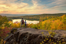 Father And Son Hike To A Beautiful Overlook In The Fall