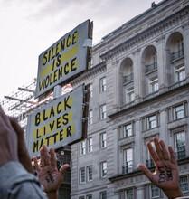 Protestor Holding Up A Black Lives Matter Sign