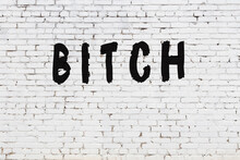 Word Bitch Painted On White Brick Wall