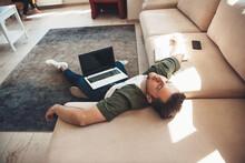 Tired Caucasian Man Lying On F...