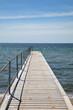 Bridge for bathing on the beach, blue sky