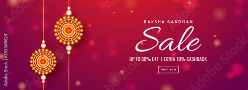 Fotomural Raksha Bandhan Sale Header or Banner Design with 50% Discount Offer, Extra 10% Cashback and Round Pearl Rakhis on Red and Pink Bokeh Background