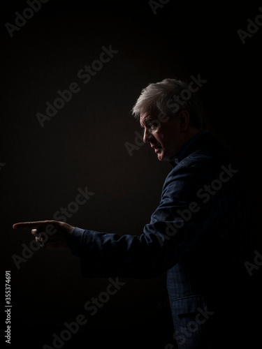 Fotomural A grey-haired dignified man in a blue suit and a tie in the image of a successfu