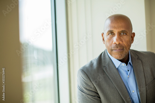 Happy mature African American man at work. Canvas Print