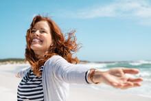 Mature Woman Enjoy Breeze At B...