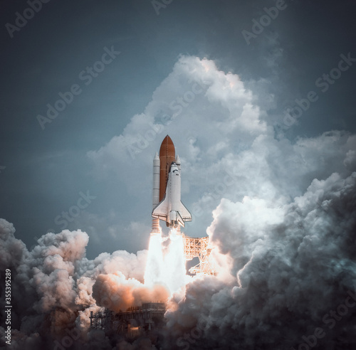 Space shuttle launches with dramatic smoke Wallpaper Mural