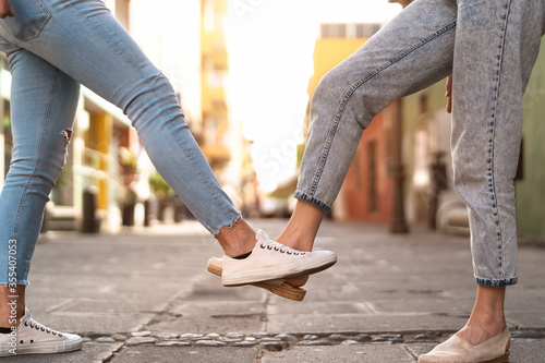 Young friends doing new social distancing greetings with foots for preventing corona virus outbreak - Physical distance and safety greetings concept