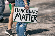 BLM: Caucasian Protester Holds...