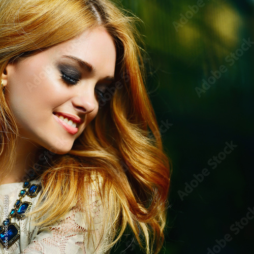 portrait of a beautiful girl with a smile in the sun
