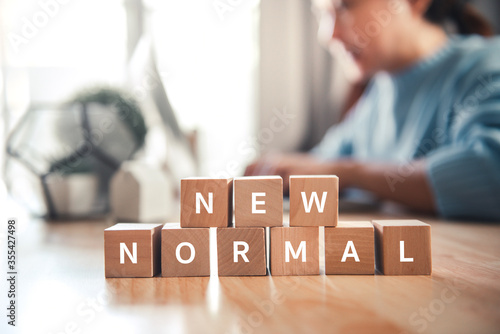 Photo Wooden cubes with NEW NORMAL word