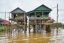 Rural Stilt Houses Of Kampong Phluk Floating Village At Tonle Sap Lake