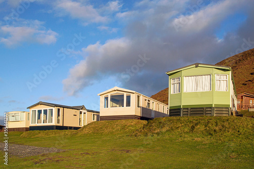 Obraz na plátně Static caravan holiday homes at Llangennith on the Gower Peninsular in winter which is out of season, the caravans are closed up until spring
