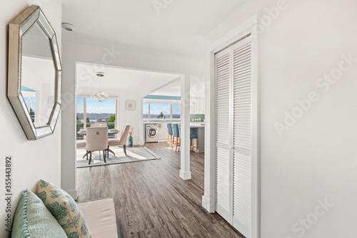 Beautiful white hallway interior with grey hardwood floors Canvas