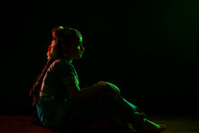 Bharatanatyam Dancer Sitting On Stage During Performance