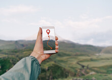 Traveler Man Holding Smartphone In A Hand And Using GPS App, Pov.