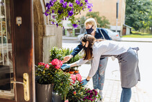 Young Woman Florist Helping Fe...