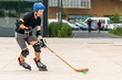 canvas print picture - Outdoor sport, ice hockey player off ice practice on rollerskates