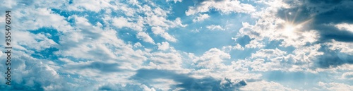Foto Backgrounds and textures. Blue beautiful sky with clouds.