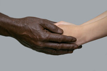 Black Male Hands Hold White Fe...