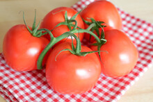 Fresh Tomatoes, Typical Mediterranean Diet Vegetables, On Wooden Table With Natural Light